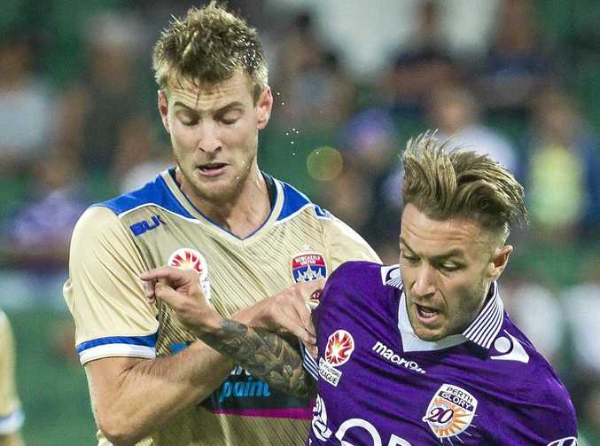 Lachlan Jackson of the Jets (left) and Adam Taggart of the Glory battle for the ball.