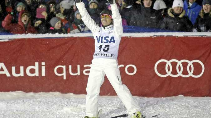 Lydia Lassila, of Australia, celebrates after jumping in the women's aerials at the World Cup freestyle skiing competition at Deer Valley.