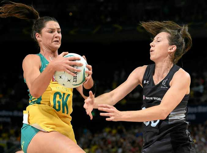 Sharni Layton of the Diamonds competes for the ball with Bailey Mes of the Silver Ferns.