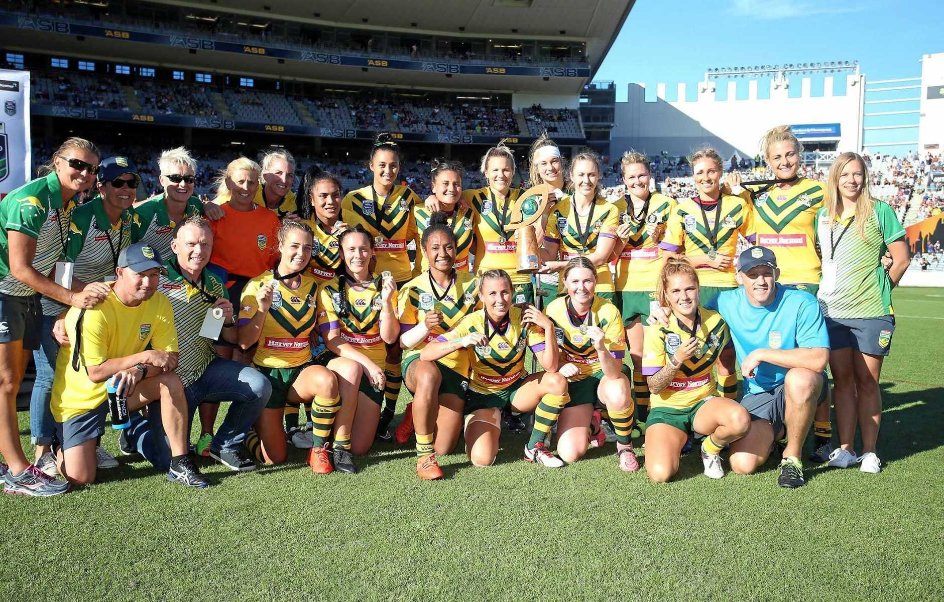 The Australian Jillaroos celebrate winning the Auckland Nines trophy against New Zealand at Eden Park.