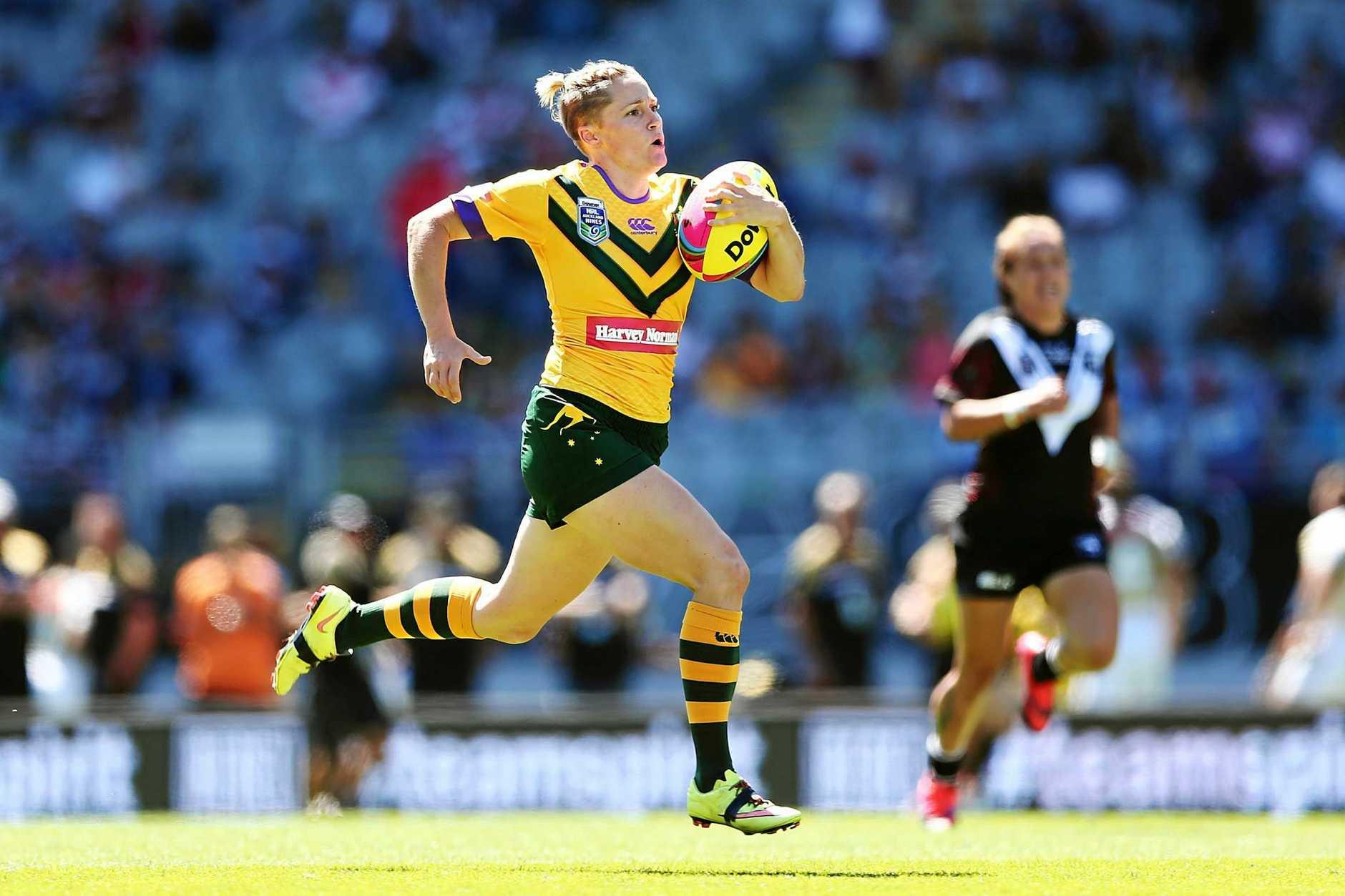 Chelsea Baker, of the Australian Jillaroos, makes a break on her way to score a try