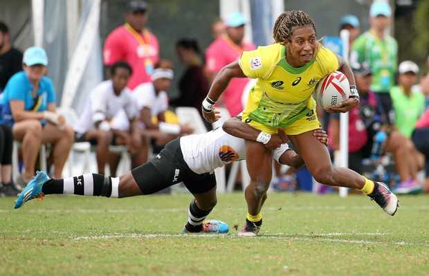 Australia's Ella Green evades a tackle from Fiji's Tima Ravisa during their women's quarter final match