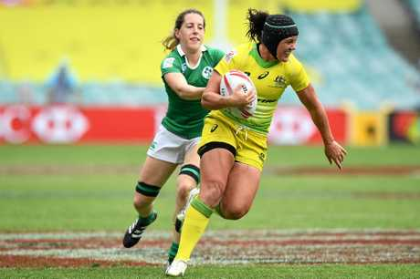 Sharni Williams of Australia is tackled by Emma Murphy of Ireland during the Women's Pool match