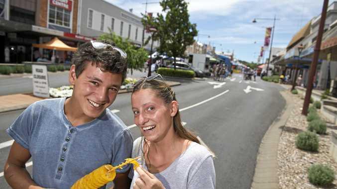 SUNDAY FUNDAY: Jonathon Amrani and Gertje Geigle share a potato spiral at the Margaret St Markets yesterday.