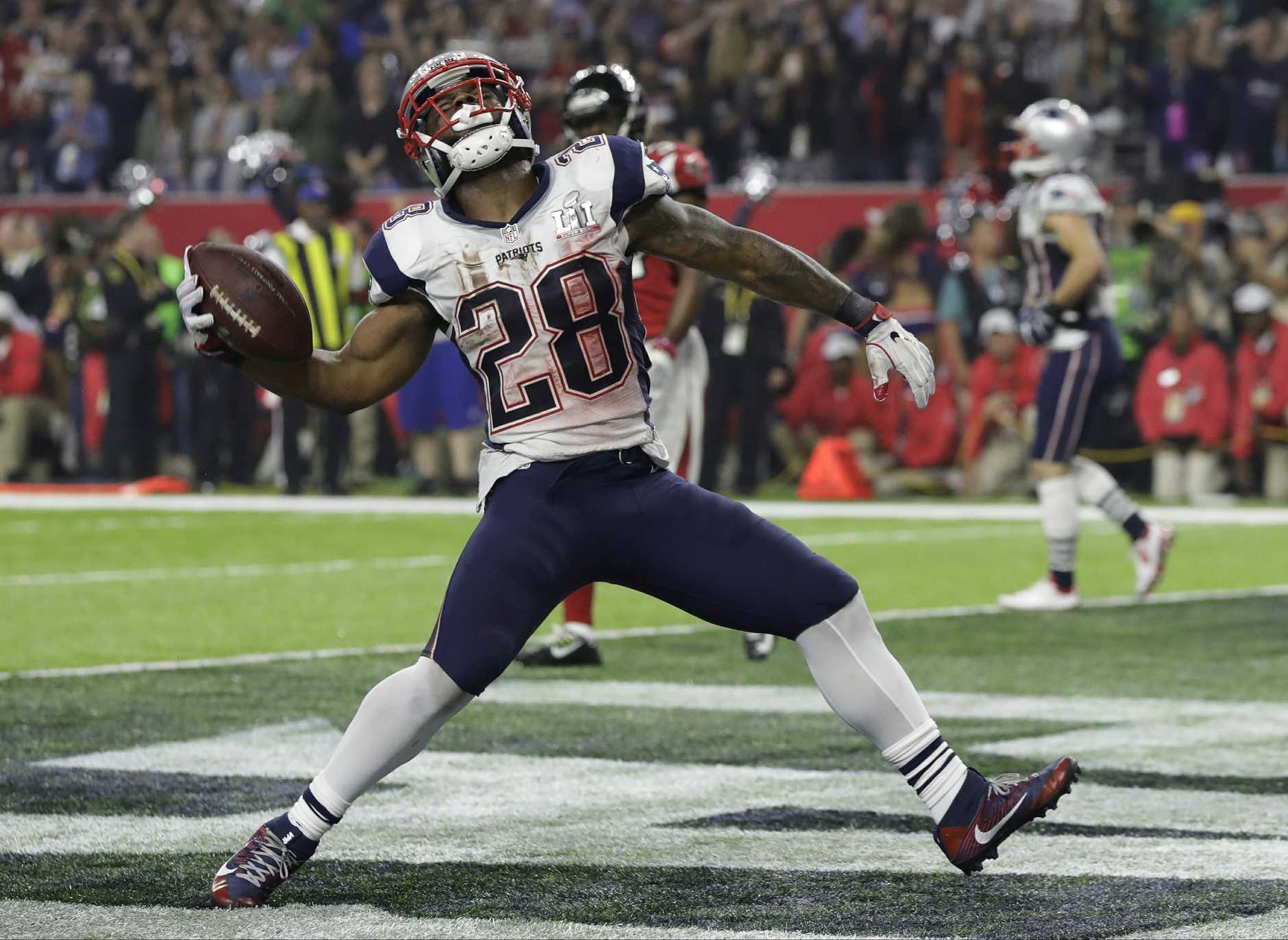 New England Patriots' James White celebrates after scoring a touchdown during the second half of the NFL Super Bowl 51 football game against the Atlanta Falcons, Sunday, Feb. 5, 2017, in Houston. (AP Photo/Chuck Burton)