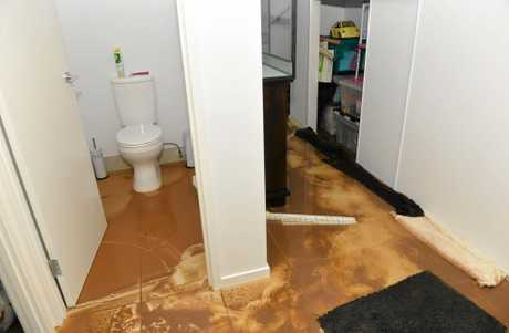 The flash flooding pushed water and mud throughout the downstairs section of a Mackay family home.
