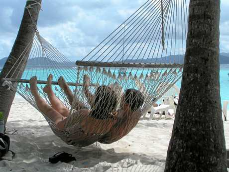 Keeping cool in a hammock. The island scenery doesn't hurt either.