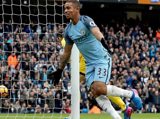 Manchester City's Gabriel Jesus celebrates after scoring his first goal in a 2-1 win over Swansea City.