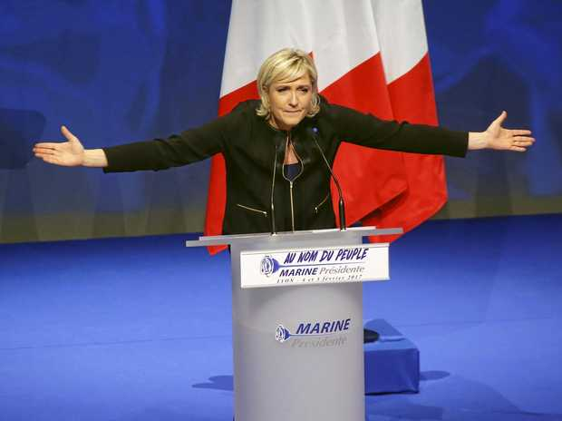 Far-right leader presidential candidate Marine Le Pen gestures as she speaks during a conference in Lyon, France, Sunday, Feb. 5, 2017. Britain's decision to leave the European Union and the election of U.S. President Donald Trump have given the French a \