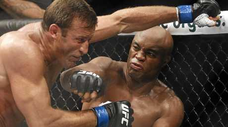 Anderson Silva throws a punch at Stephan Bonnar during their light heavyweight bout at UFC 153 in Rio de Janeiro in 2012.
