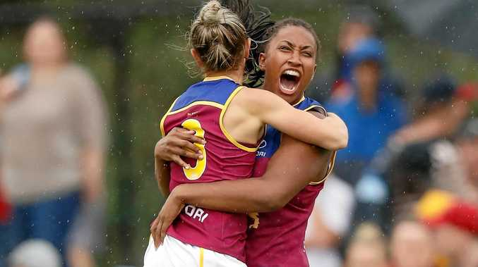 Kate McCarthy and Sabrina Frederick-Traub (right), of the Lions, celebrate their team's win at Casey Fields.