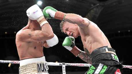 Anthony Mundine (left)  and Danny Green during the Boxing fight night between Anthony Mundine and Danny Green at the Adelaide Oval in Adelaide, Friday, Feb. 3, 2017.  (AAP Image/David Mariuz) NO ARCHIVING, EDITORIAL USE ONLY