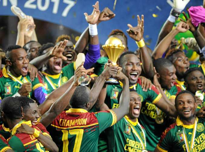Cameroon players celebrate after defeating Egypt to win the Africa Cup of Nations.