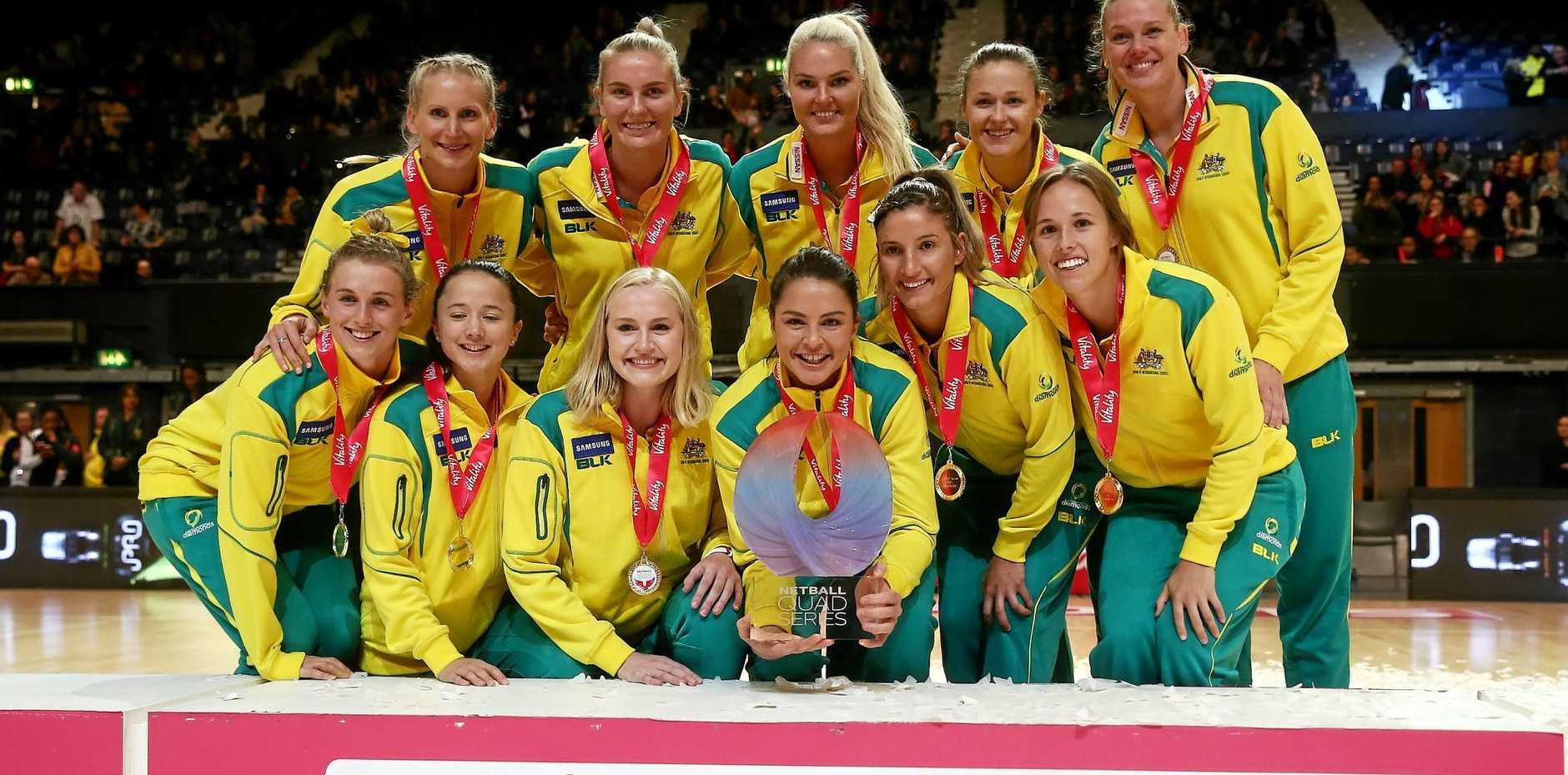 Captain Sharni Layton (centre) lifts the trophy with the Australia team after winning the Quad Series against the England Roses.