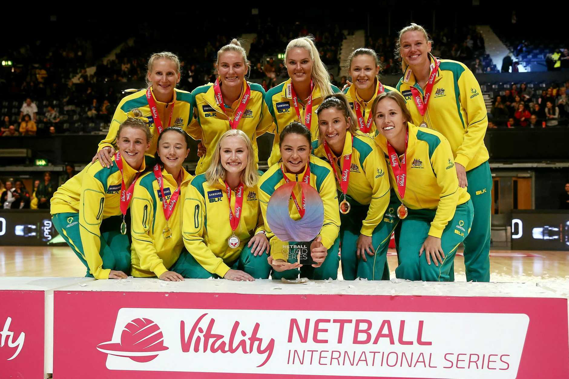 Captain Sharni Layton (centre) lifts the trophy with the Australia team after winning the Quad Series with a victory over England.