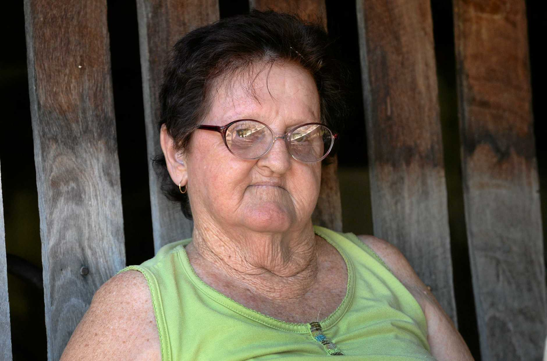 Margaret Evans' son and carer was assaulted and robbed shortly after leaving a CBD hotel early Saturday morning by a group of four people.