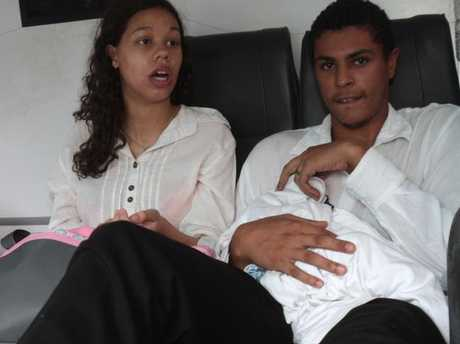 Heather Mack and then-boyfriend Tommy Schaefer hold their baby inside a prosecutor's car on the way to Denpasar District Court for their trial in Bali.