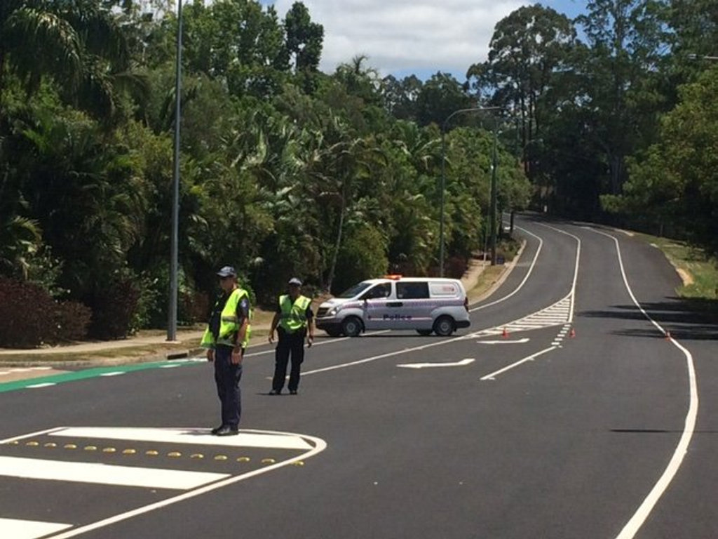 Police stop traffic on Petrie Ck Rd as firefighters inspect a suspicious chemical find on a nearby property.