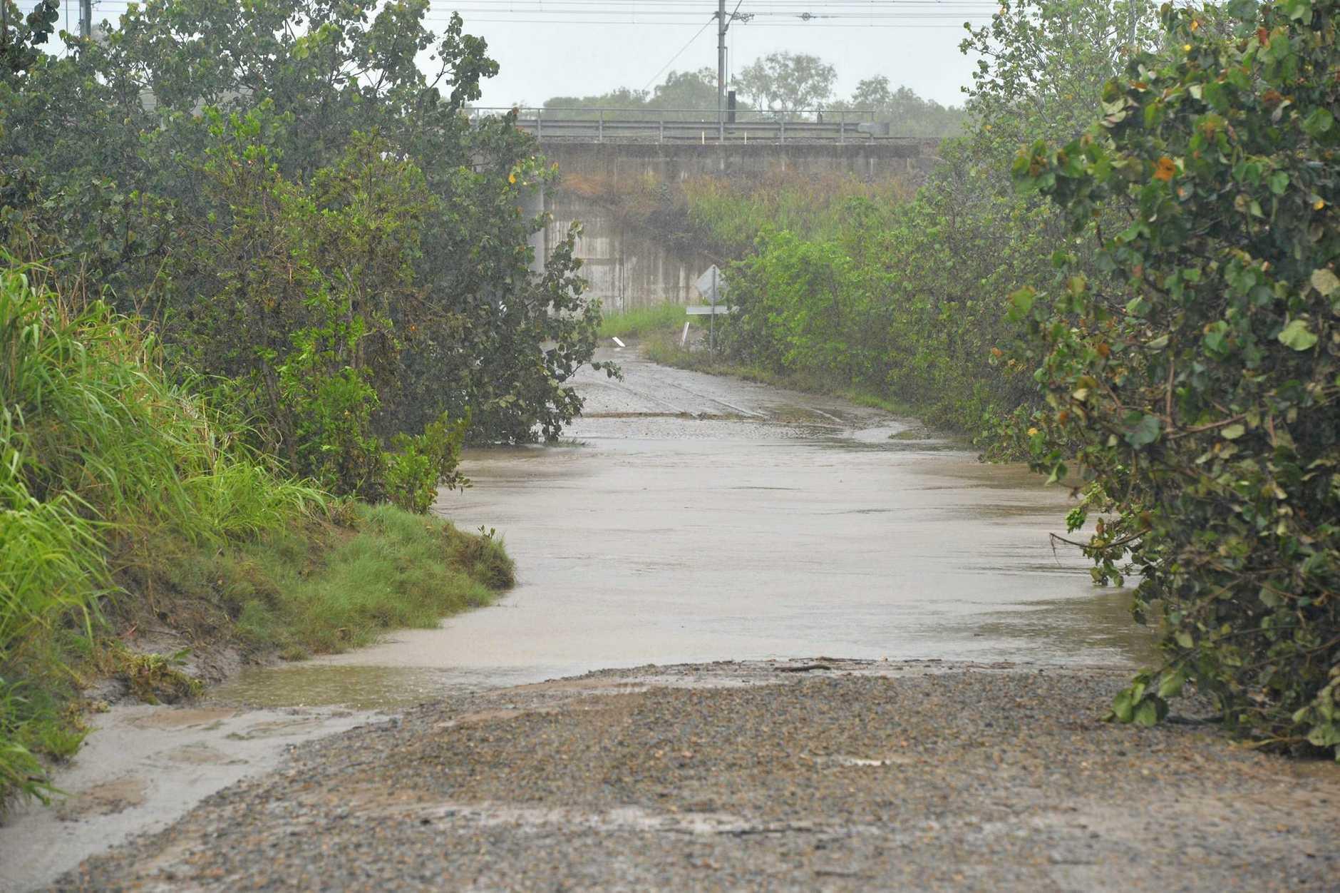 Water covers the bitumen at Brooks Road, Sarina.