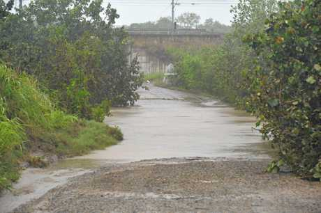 Water covers the bitumen at Brooks Road, Sarina.