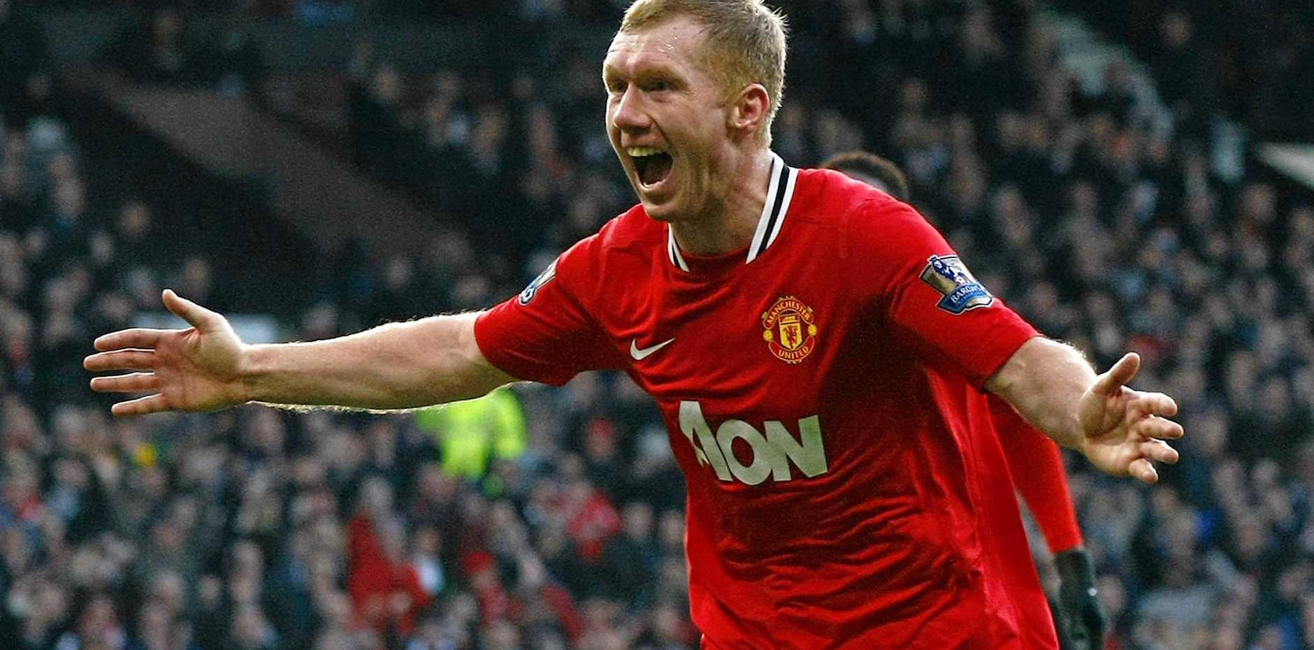 Manchester United's Paul Scholes celebrates scoring a goal in the English Premier League.