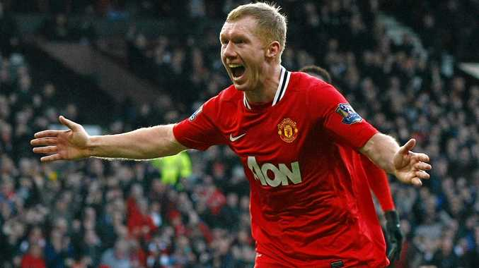 Manchester United's Paul Scholes celebrates scoring a goal in the English Premier League.