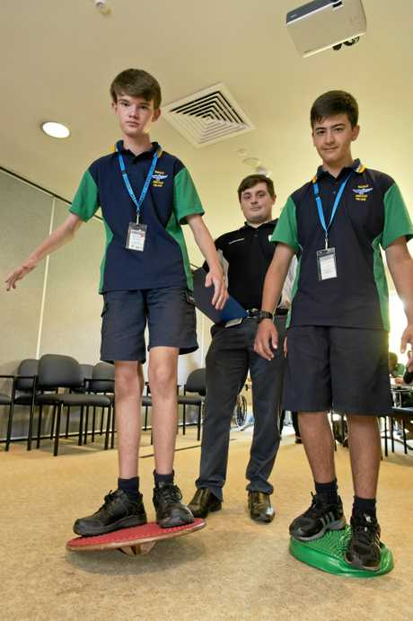 Feeling the sense of having no balance are Warwick Christian College students Brandon Gunton (left) and Thiart Kruger with Central Queensland University physiotherapist Fraser Adamson.