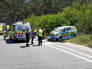 Man injured after van rolls off Pacific Hwy