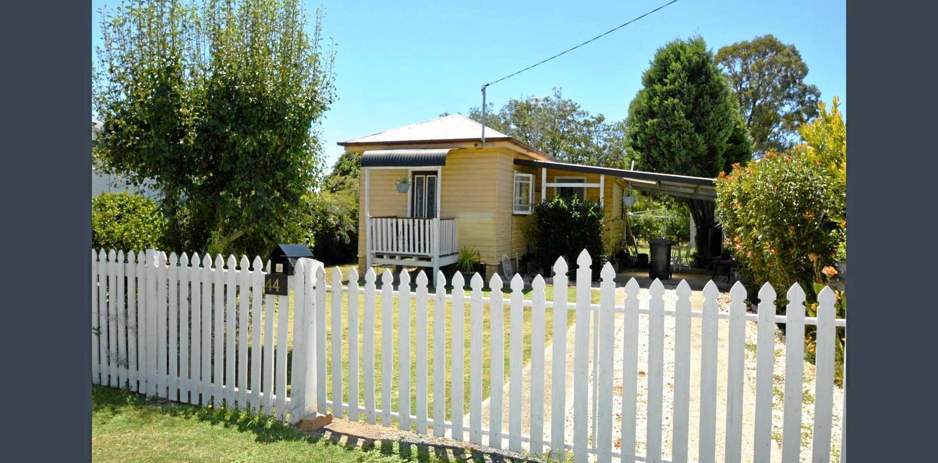 POCKET-SIZED HOUSE: The property in Warwick has one bedroom and two small decks.