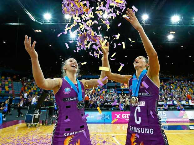 Mahalia Cassidy and Kim Ravaillion of the Firebirds celebrate during the 2016 ANZ Championship grand final.