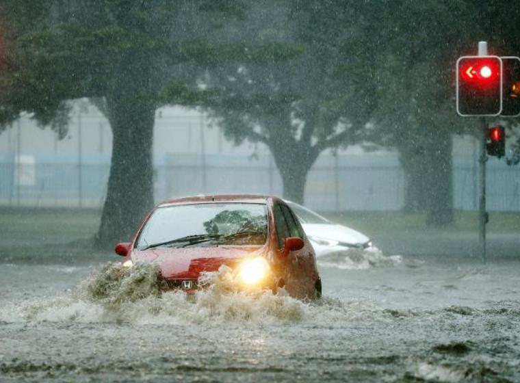 Drivers near the SCG drive through flood waters.Source:News Corp Australia