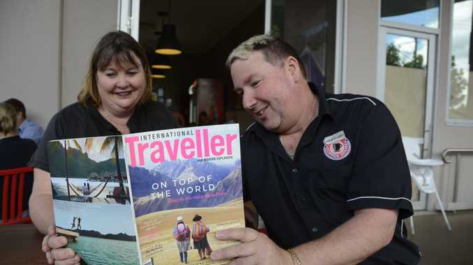 COME FLY WITH US: Gary and Michelle Kitchen started Travellers Coffee House, which combines a cafe and a travel company into one location, last year.