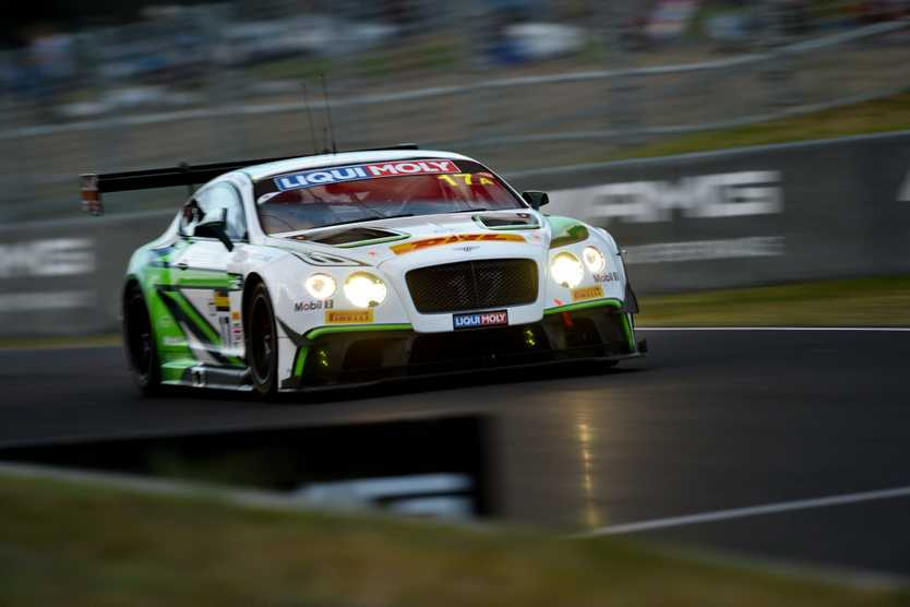 DARK START: The thumping Bentley Continental GT3 roars along in the Bathurst 12 Hour's opening laps before sun up.