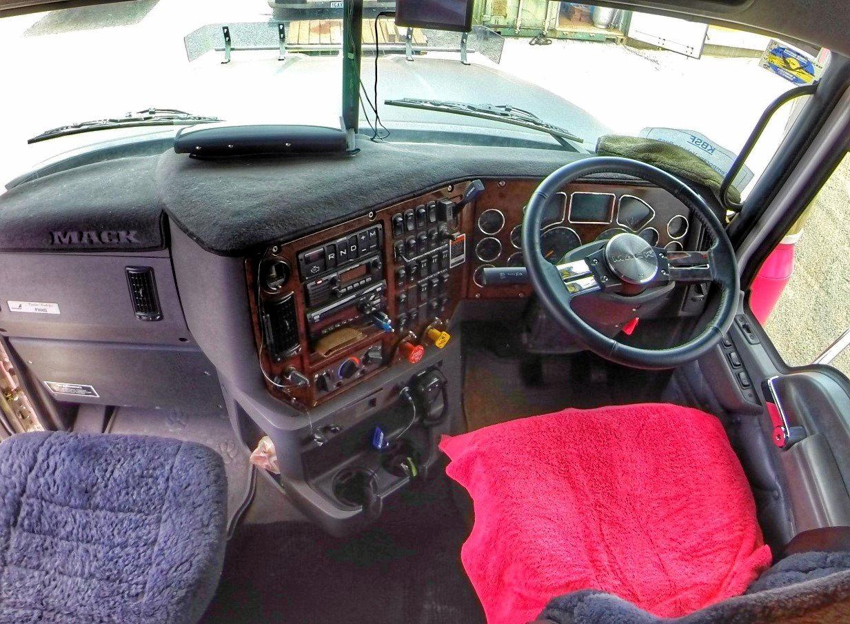 Behind the wheel of a Mack Super-Liner in a road train   Big