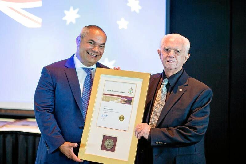 Sports achievement award winner Don Robertson, 91, is congratulated by Gold Coast mayor Tom Tate.