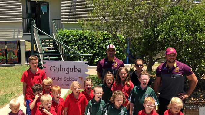 SPECIAL OCCASION: Guluguba and Grosmont State School kids with Broncos Herman Eseese and Mitchell Dodds, 100 years on from the school's opening.
