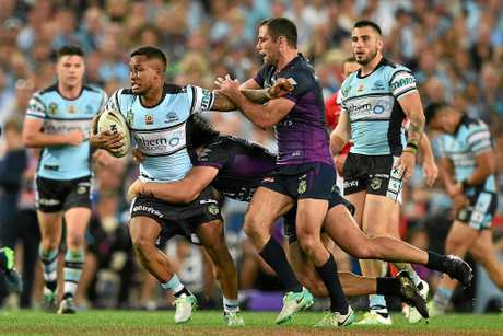 Ben Barba of the Sharks is tackled by Tohu Harris and Cameron Smith, (right), of the Storm during the NRL Grand Final between the Melbourne Storm and the Cronulla-Sutherland Sharks at ANZ Stadium in Sydney, Sunday, Oct. 2, 2016. (AAP Image/Dan Himbrechts) NO ARCHIVING, EDITORIAL USE ONLY