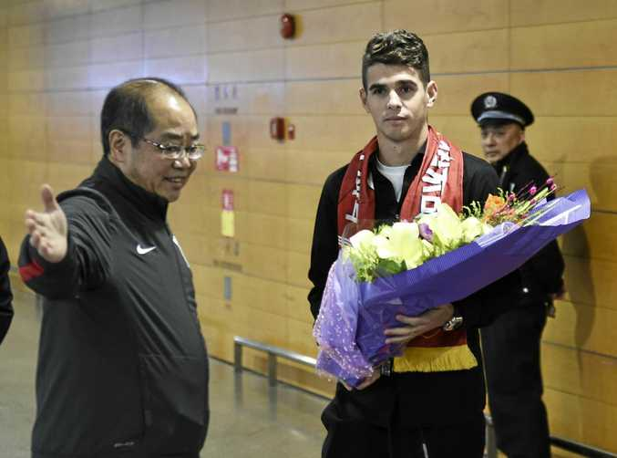 Brazilian football player Oscar, right, has been welcomed with open arms in Shanghai.