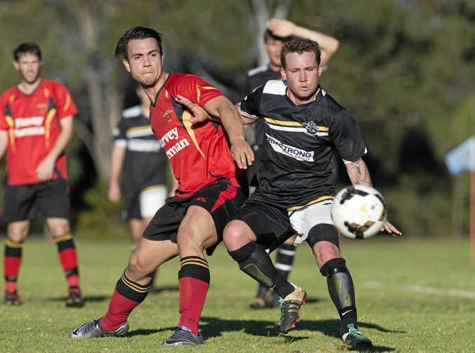 BACK ON THE PITCH: Gatton player Zachary Kaddatz and Ashley Freier of West Wanderers in SWL Toowoomba Premier Men football semi-final.