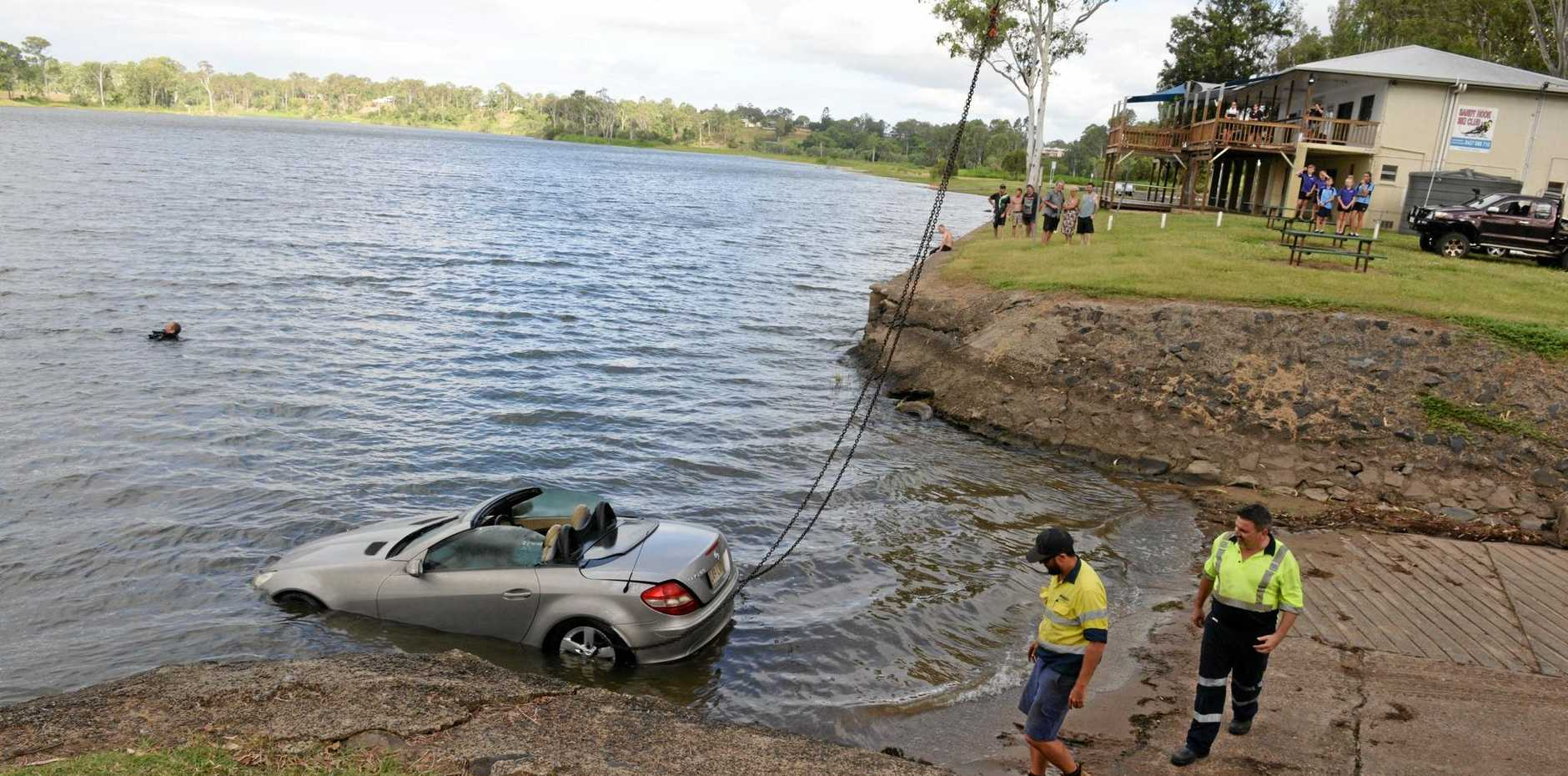 A Mercedes is pulled from the Burnett River at Sandy Hook.