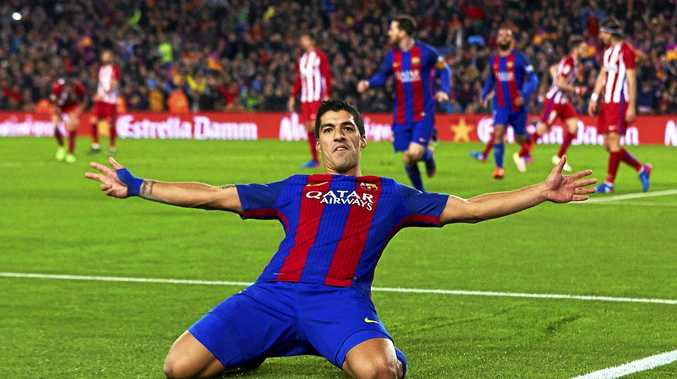 Barcelona's Uruguayan striker Luis Suarez celebrates after scoring during the Copa del Rey semi-final against Atletico Madrid at the Nou Camp.