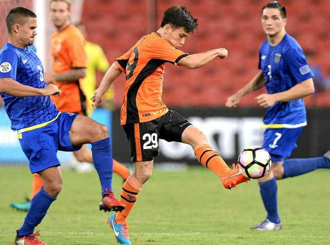 Joe Caletti of the Roar gets a kick away during the Asian Champions League playoff against Global FC at Suncorp Stadium.