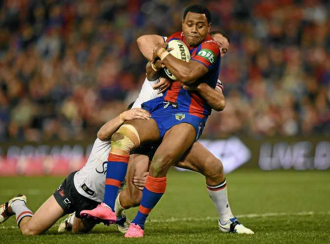 Akuila Uate makes a run for the Newcastle Knights.