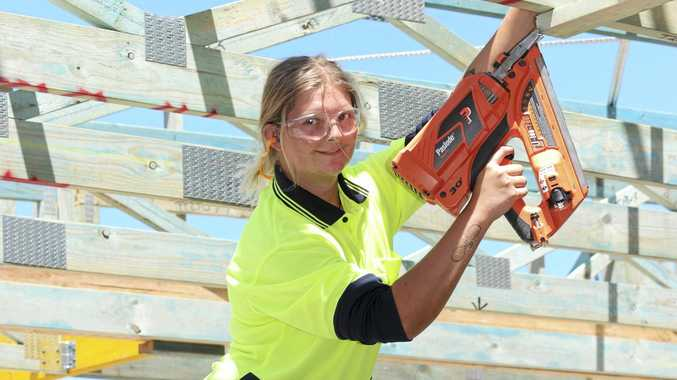 Sunshine Coast carpentry apprentice Amelia Robertson slogs it out on the job.