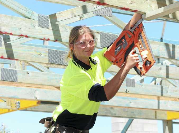 Sunshine Coast carpentry apprentice Amelia Robertson slogs it out on the job.