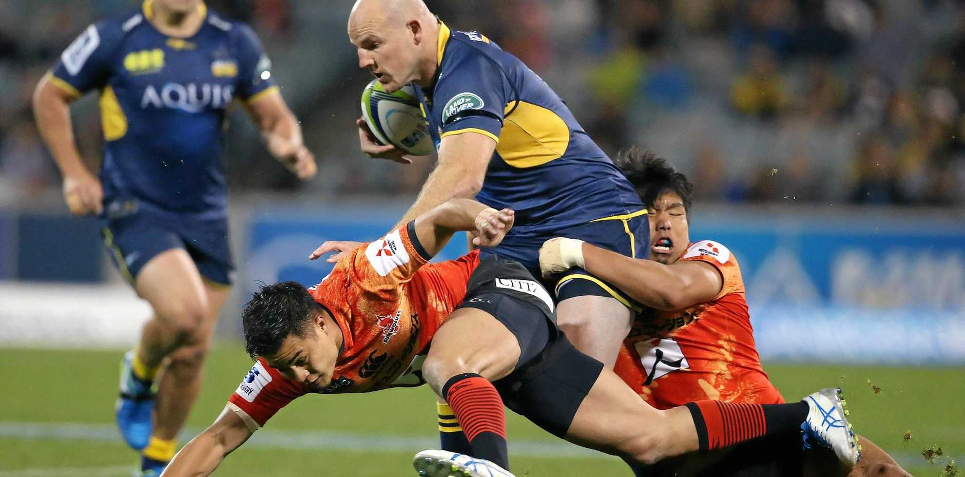 Stephen Moore of the Brumbies powers through the Sunwolves.