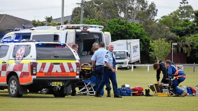Emergency services treating the 47-year-old woman seriously injured in a motorbike crash at East Ballina.
