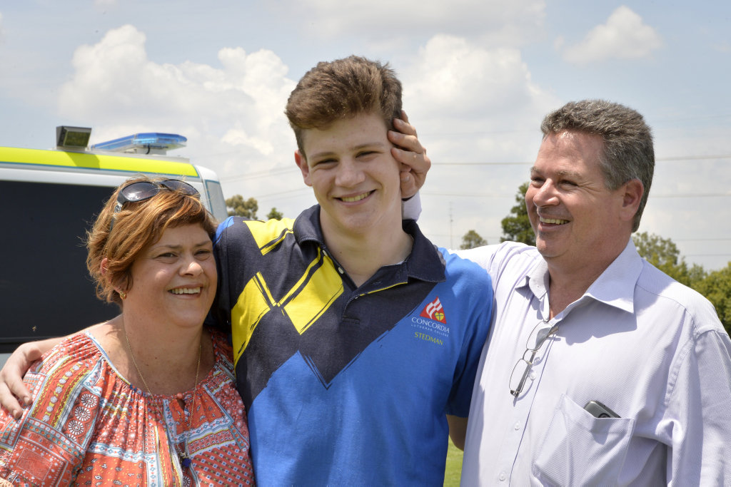 OUR BOY: Fifteen-year-old Connor Sharpe with his parents, Wendy and Scott Sharpe. Connor suffered a cardiac arrest at the Brothers Leagues Club after he have played a game of Rugby League. Photo Bev Lacey / The Chronicle