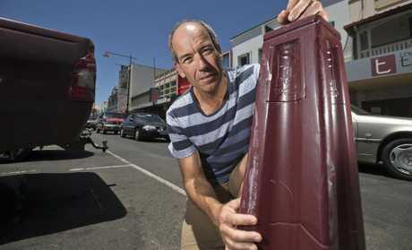 Margaret St office worker Paul Herbert says he regularly sees drivers turning into parking bollards and causing thousands of dollars of damage to their car simply because the bollards are too short, Tuesday, February 7, 2017.