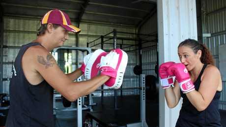 Darren Prowse helps train his sister Christina Karehana at the Sarina Leagues Club gym.
